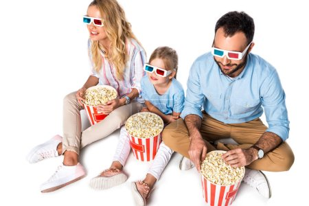 family with popcorn and 3d glasses sitting on white cube isolated on white