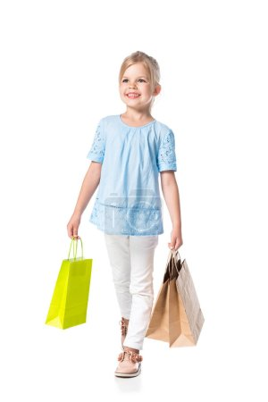 Photo for Smiling child with shopping bags isolated on white - Royalty Free Image