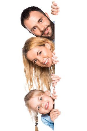 smiling family with empty board isolated on white