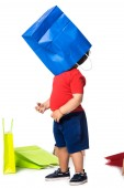 boy playing with blue shopping bag isolated on white