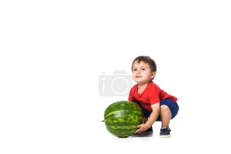kid trying to raise watermelon isolated on white