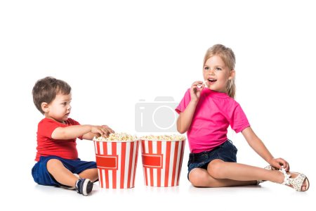 kids with popcorn and 3d glasses isolated on white