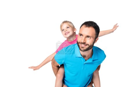 Photo for Smiling father giving piggyback to daughter isolated on white - Royalty Free Image