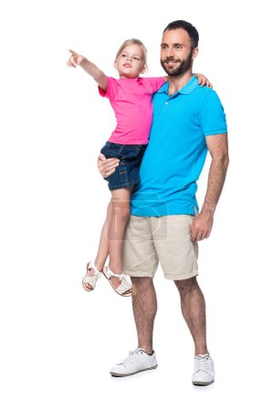 father holding daughter on hands while she showing on something isolated on white