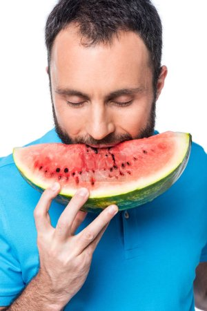 man biting watermelon isolated on white