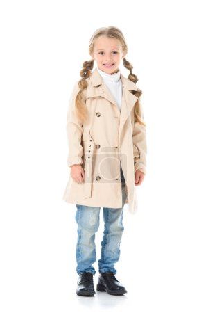 adorable kid posing in beige coat, isolated on white