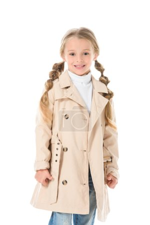 Photo for Adorable smiling kid posing in beige autumn coat, isolated on white - Royalty Free Image