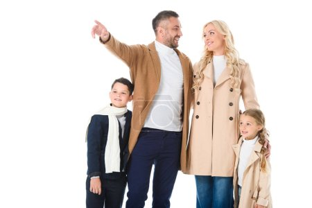 stylish family and children in autumn outfit, father showing something isolated on white