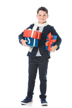 Photo for Stylish boy holding gift boxes, isolated on white - Royalty Free Image