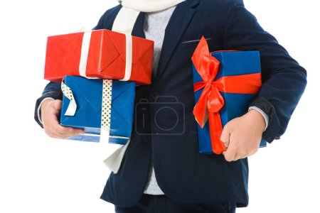 cropped view of boy holding gift boxes, isolated on white