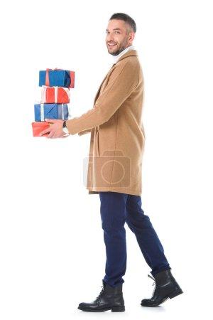 stylish man in beige coat holding gift boxes, isolated on white