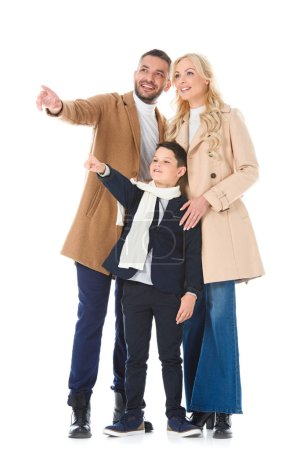 family and son in autumn beige coats showing something isolated on white