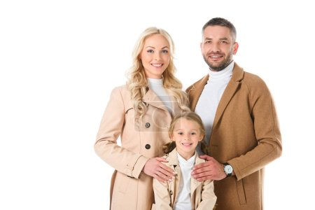 smiling family with daughter in beige autumn coats, isolated on white