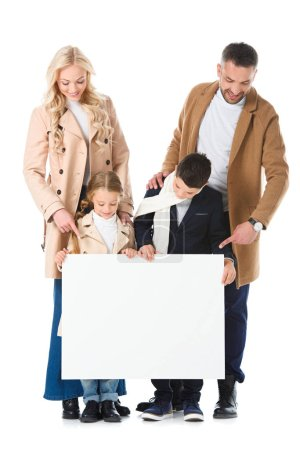 stylish family and kids in beige coats holding empty board, isolated on white