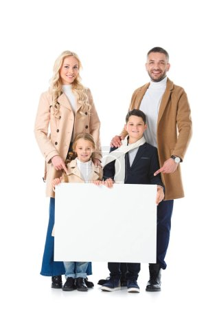 parents and kids in beige coats holding blank placard, isolated on white