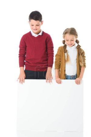 brother and sister standing with empty board, isolated on white