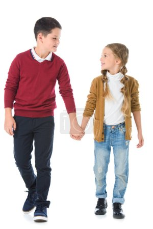 brother and sister holding hands isolated on white