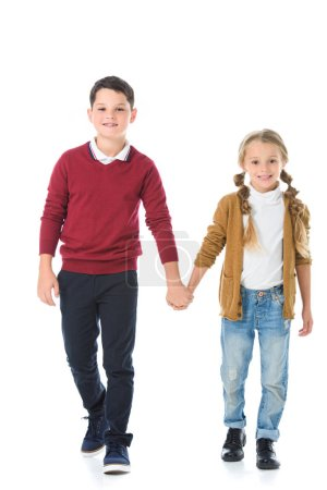 happy siblings holding hands isolated on white