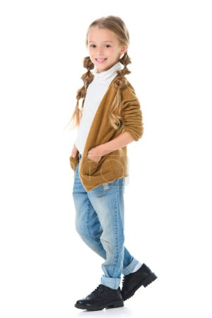adorable smiling kid posing in autumn outfit, isolated on white