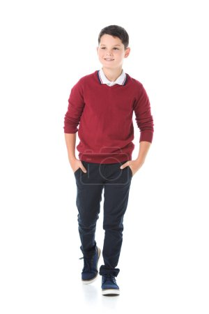 smiling boy posing in red sweater isolated on white