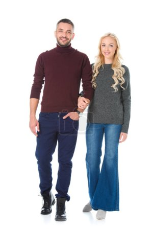 beautiful couple posing in autumn outfit, isolated on white