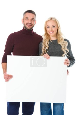 smiling couple in autumn outfit holding empty board, isolated on white