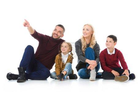 Photo pour Parents heureux assis avec des enfants, père montrant quelque chose d'isolé sur blanc - image libre de droit