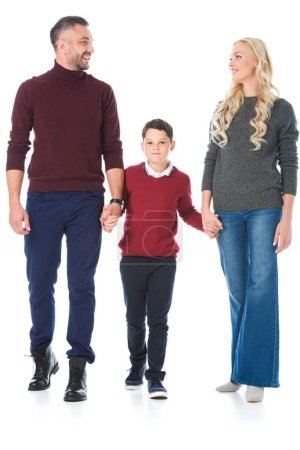 parents and son holding hands and posing in autumn outfit, isolated on white
