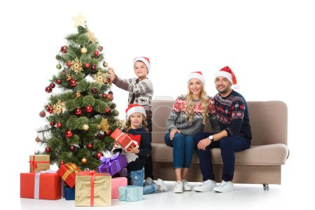 happy family with children near christmas tree with presents, isolated on white