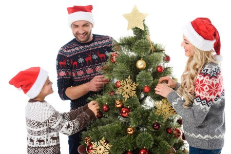 parents with son with santa hats decorating christmas tree, isolated on white