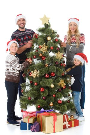 happy family decorating christmas tree with presents, isolated on white