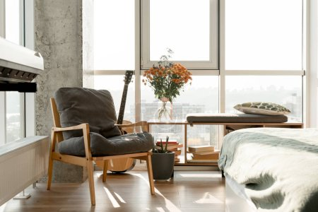 close up view of empty modern room interior with armchair at big window