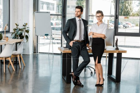 young stylish business colleagues standing in office
