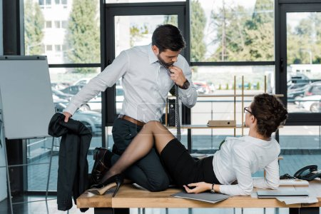 passionate businessman and businesswoman at workplace in office