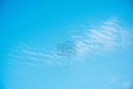 beautiful light blue sky with clouds as background