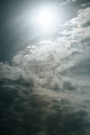beautiful white clouds with sunlight at grey sky