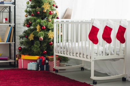 interior of christmas decorated baby room with infant bed