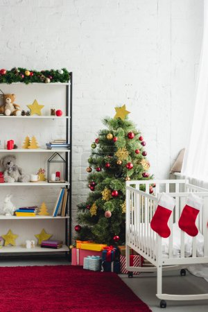 interior of christmas decorated baby room with cradle