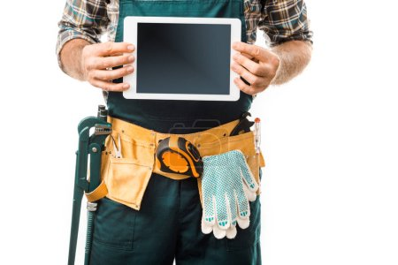 cropped image of plumber showing tablet with blank screen isolated on white