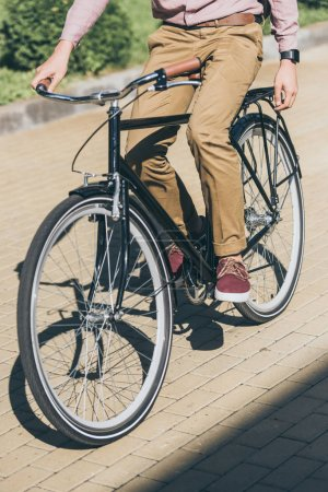 Photo for Partial view of stylish man riding bicycle on street - Royalty Free Image