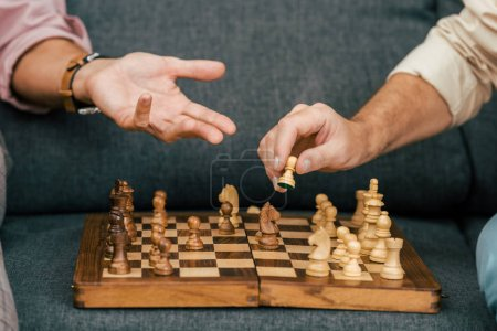 Photo for Cropped shot of men playing chess together on couch - Royalty Free Image