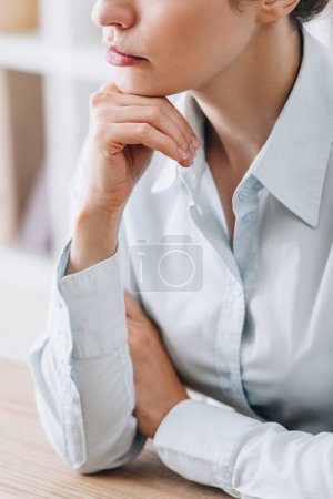 Photo for Cropped shot of adult businesswoman touching chin with hand at office - Royalty Free Image