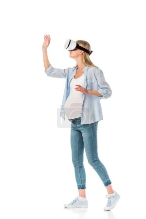 Photo for Expressive pregnant woman in vr headset gesturing with hands isolated on white - Royalty Free Image