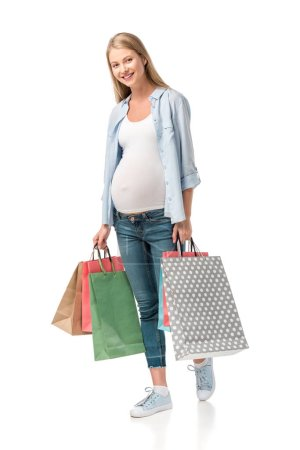 pregnant customer holding shopping bags isolated on white