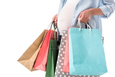Photo for Cropped view of pregnant woman with shopping bags isolated on white - Royalty Free Image