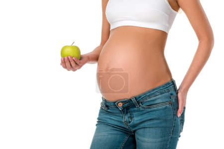 cropped view of pregnant woman holding green fresh apple isolated on white