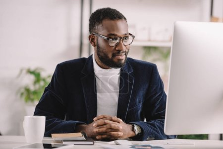 successful african american businessman working with computer in modern office