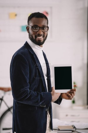 successful african american businessman presenting digital tablet with blank screen