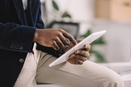 Photo for Cropped view of african american businessman using digital tablet - Royalty Free Image
