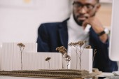 selective focus of business buildings model and african american engineer